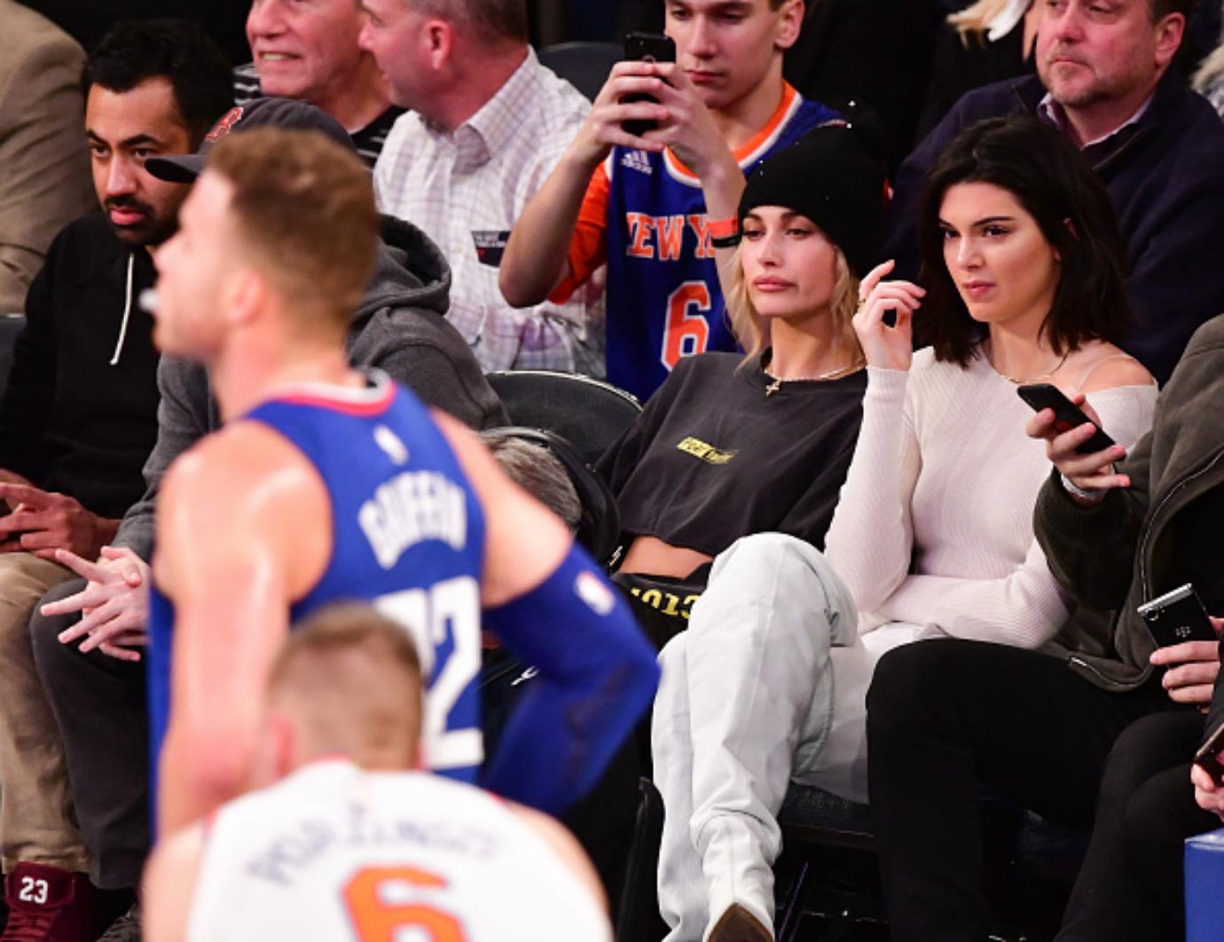 Kendall Jenner sits courtside cheering on Blake Griffin.