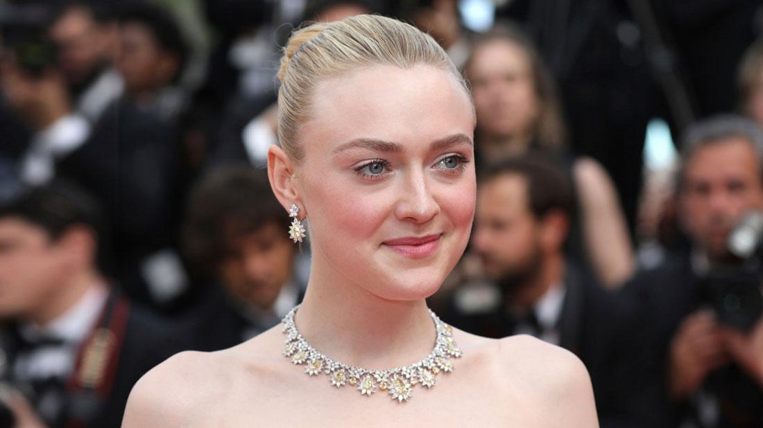 Dakota Fanning Wearing White and Yellow Diamond Earrings and Necklace Shocks Fans By Posting Nude Photo Of Herself Doing Makeup In Bathroom