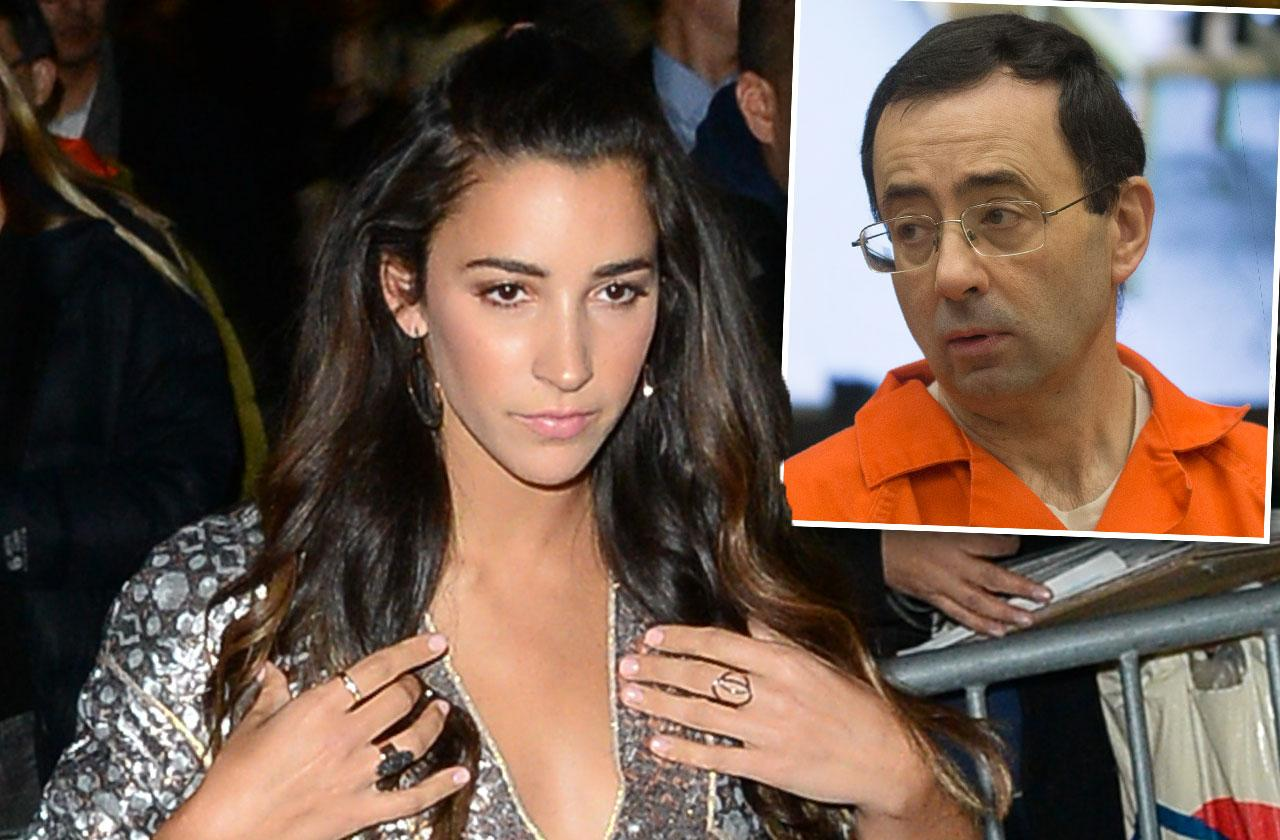 //Aly Raisman Sues US Olympic Committee pp