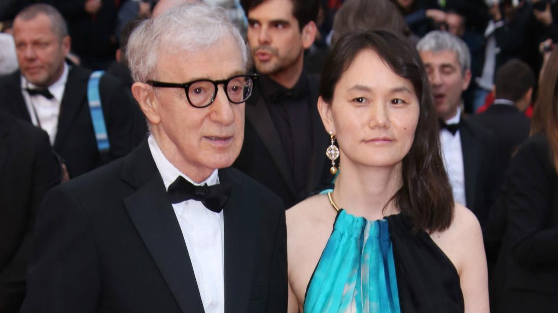 Woody Allen, in a classic tux, held hands with his wife, Soon-Yi Previn, as she wore a sleeveless blue, black and white dress.