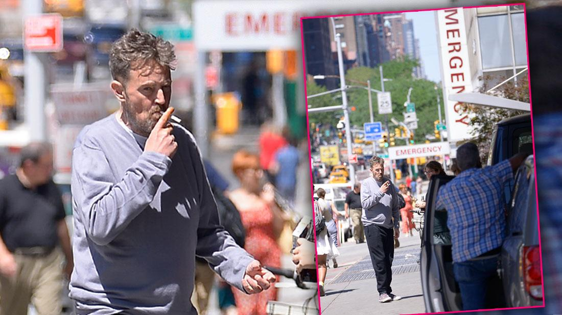 Matthew Perry Wearing Grey Top Smoking a Cigarette On A NYC Street In Font Of Hospital