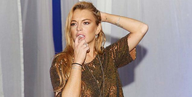 //lindsay lohan sober living coach moved out
