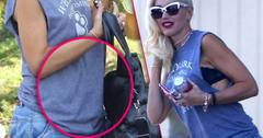 Gwen Stefani Holds Big Purse In Front Of Baby Bump