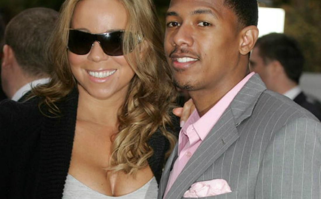 Mariah Carey and Nick Cannon pose for a photo.