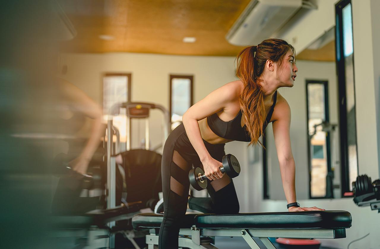 woman-using-dumbbell