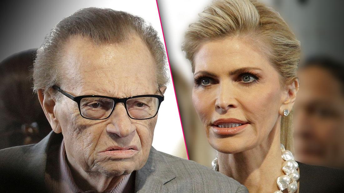 Larry King Wearing Gray Suit looking Angrily at Wife Shawn Equally Angry Wearing Black Suit