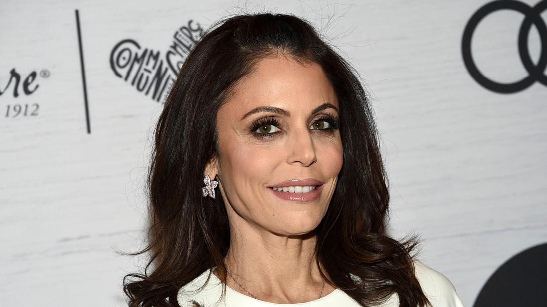 Bethenny Frankel Closeup Smiling Wearing Floral Earrings and White Dress
