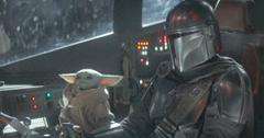 The Mandalorian (Pedro Pascal) wore the classic bounty hunter uniform as he flew his ship, while Baby Yoda caused mischief.