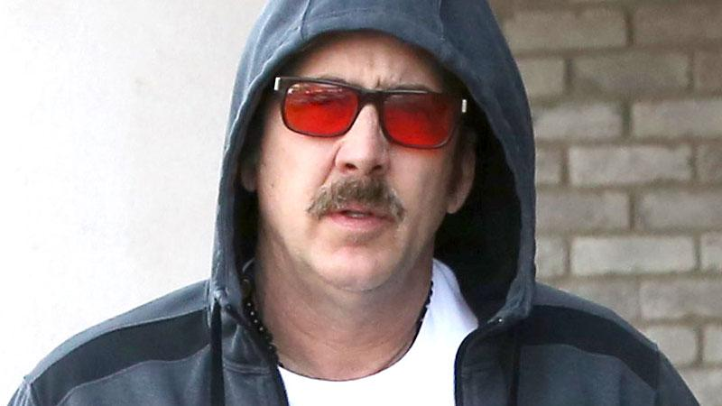 //down out nicolas cage rents modest condo pp