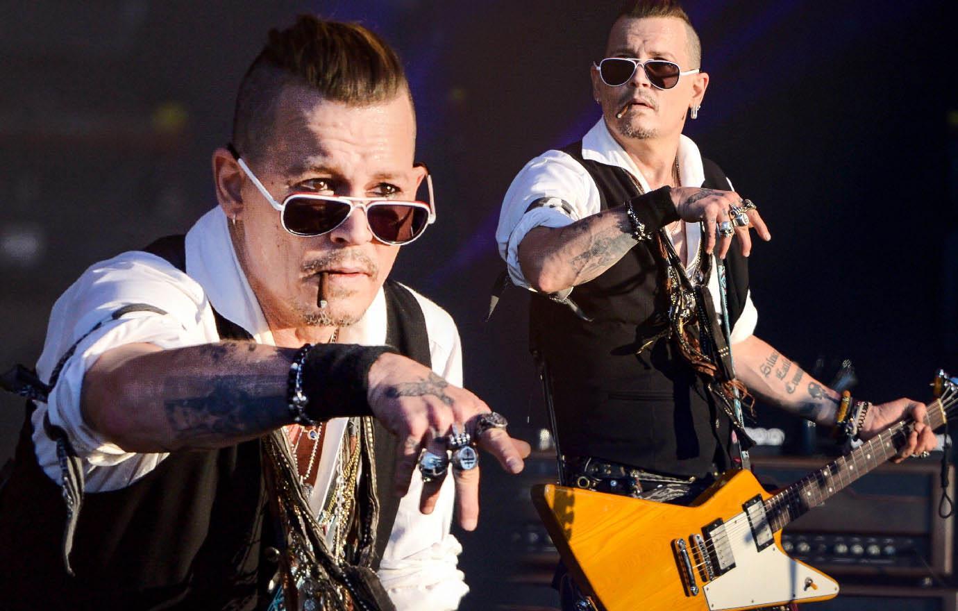 Johnny Depp Performs After Booze Bender Revelations