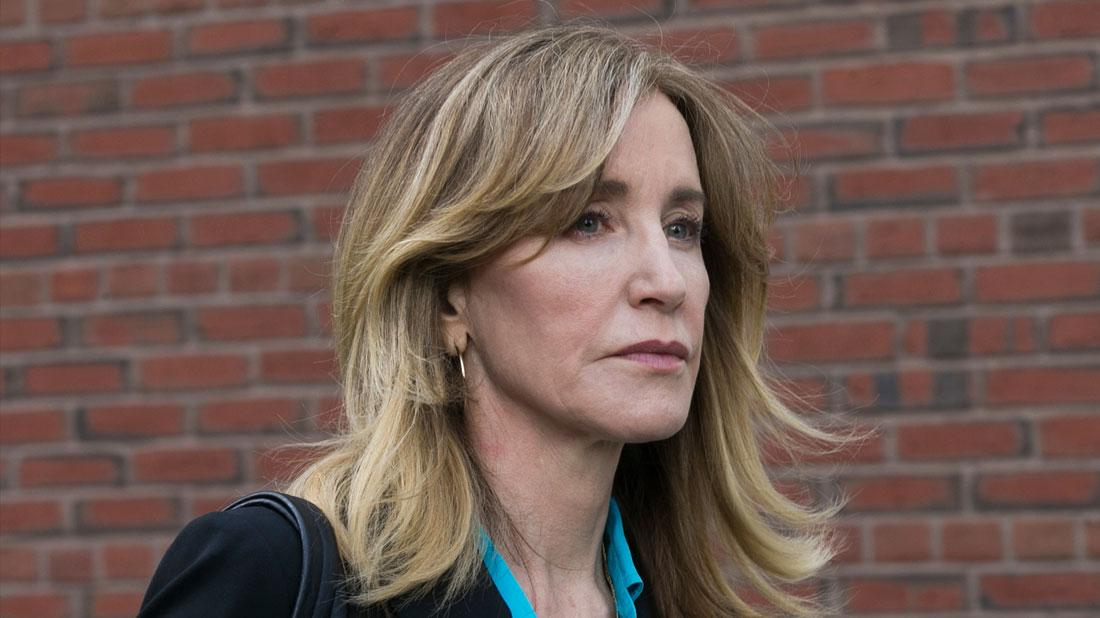 US actress Felicity Huffman leaves the John J Moakley Federal Court House after facing charges in a nationwide college admissions cheating scheme in Boston, Massachusetts.