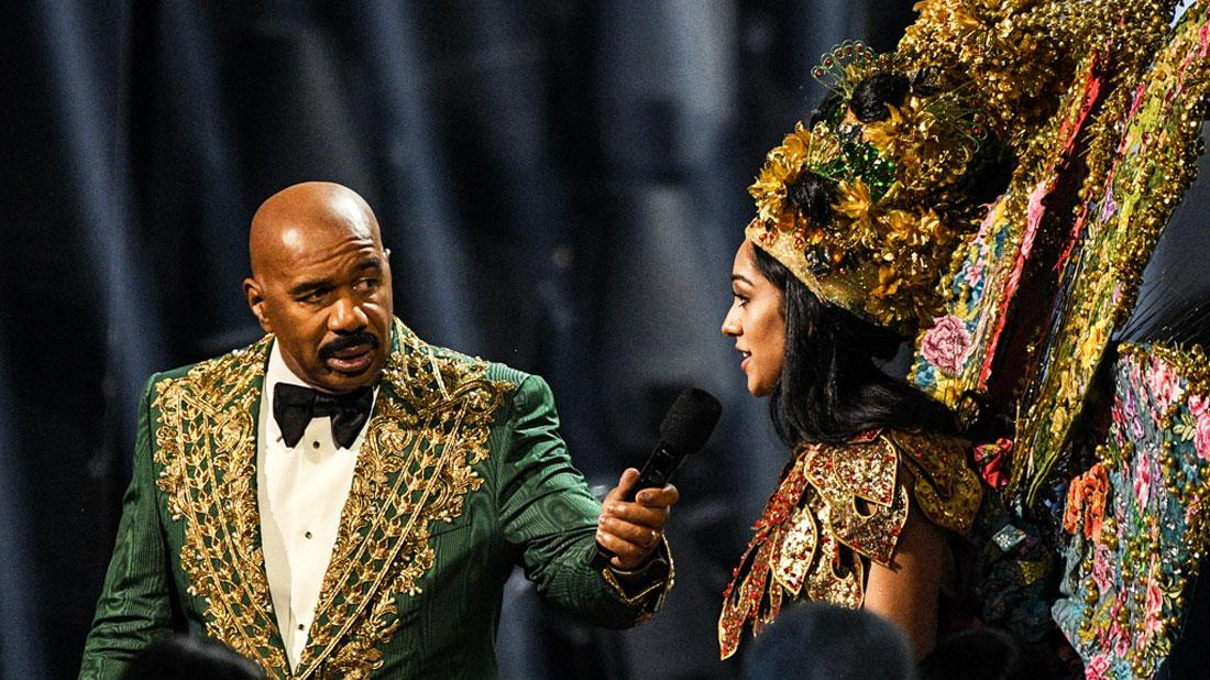 Steve Harvey and Miss Malaysia Shweta Sekhon at the Miss Universe Competion 2019