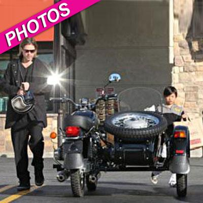 //brad pitt pax motorcycle gelsons shopping