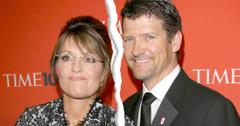 Ripped Down The Middle Photo Of Sarah Palin Wearing Black and White Lace Dress Standing Next To Husband Todd Palin Wearing Dark Gray Sui