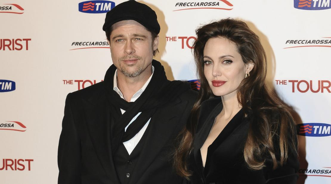 Angelina Jolie and Brad Pitt were back in black at the premiere of Jolie's film with Johnny Depp, The Tourist, in Rome, Italy.