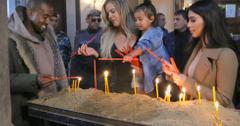 Kim & Khloe Kardashian Light A Candle In Armenia With North West