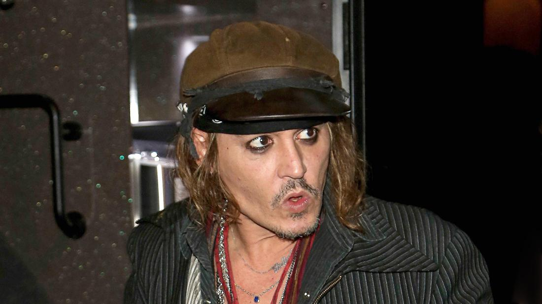 Johnny Depp 'Inhaling Booze Like Water' As Court Battle With Ex Continues To Rage