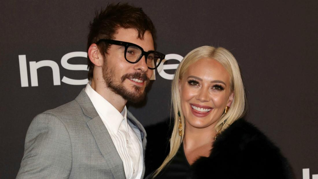 Matthew Koma and Hilary Duff walked the red carpet at an InStyle event with the Younger star wearing a black dress and Koma wore a grey suit jacket.