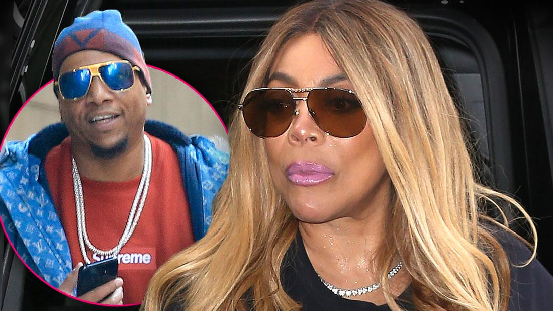 Inset Kevin Hunter Wearing Chains Around His Neck, Sunglasses, Blue And Red Hat, Red Supreme Shirt And Blue LV Parka, Wendy Williams Looking Sad Wearing Pink Lipstick, Sunglasses And Black T-Shirt